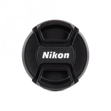 Крышка на объектив с надписью Nikon